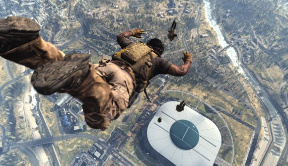 A Warzone player parachutes from the helicopter towards Stadium