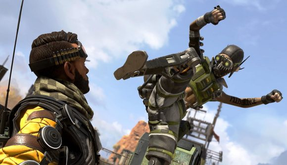Apex Legends' Octane readies his mechincal leg to stamp on Mirage, who lies prone on the floor