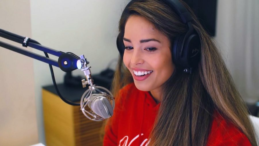 Valkyrae streaming while wearing a red sweater