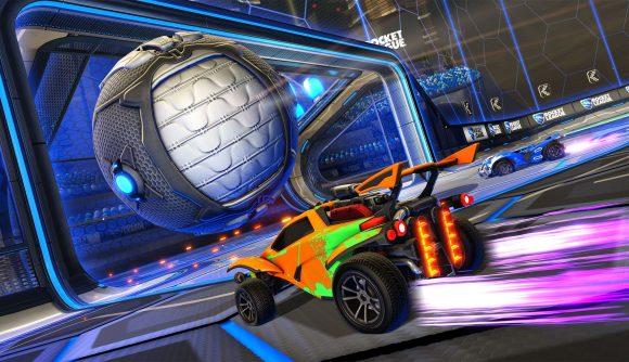 A car pushes a giant ball towards a goalmouth