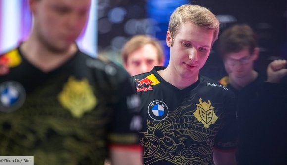 League of Legends player Jankos walking off stage wearing a black and gold G2 jersey