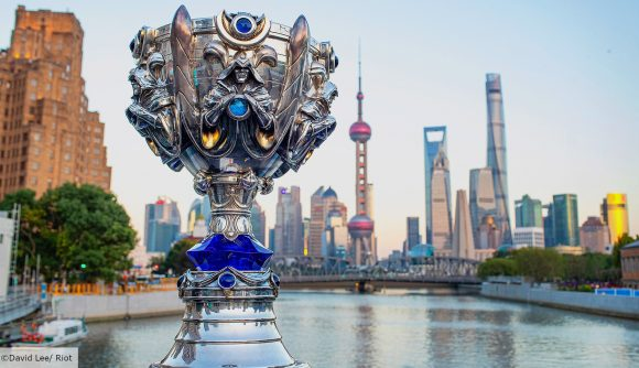 The LoL Worlds trophy with Shanghai's city skyline in the background