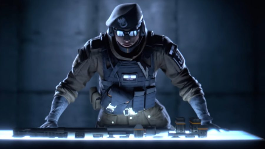 Rainbow Six Siege's Zofia in a darkly lit room with her hands on a table and looking menacing