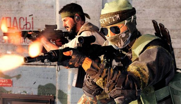 Two operators, one wearing a bandana, the other wearing a hood, bandana, face mask, and sunglasses, firing assault rifles