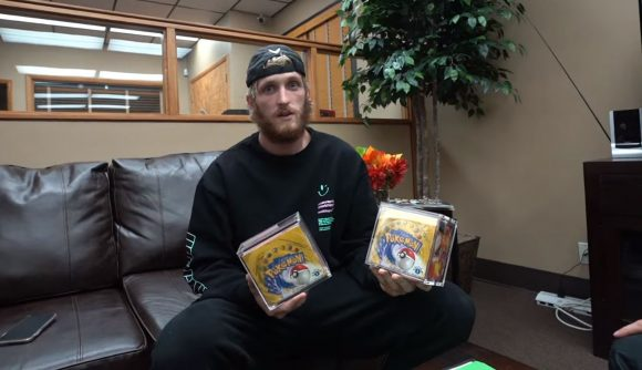 YouTuber Logan Paul holding two rare vintage Pokémon card booster boxes