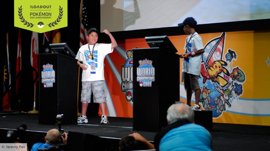 Jeremy Fan punches the air on stage, standing behind a Pokémon World Championships branded podium