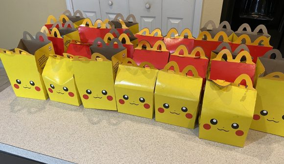 Pikachu-themed Happy Meal boxes lined up on a kitchen counter