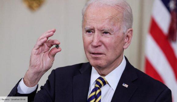 US President Joe Biden holds up a tiny semiconductor