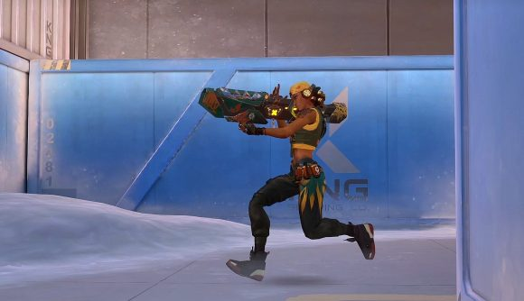 Valorant agent Raze running with a rocket launcher in front of the icy backdrop of Icebox