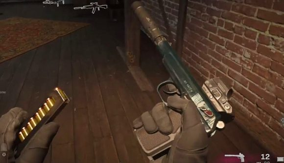 A player reloading the Sykov pistol in Warzone