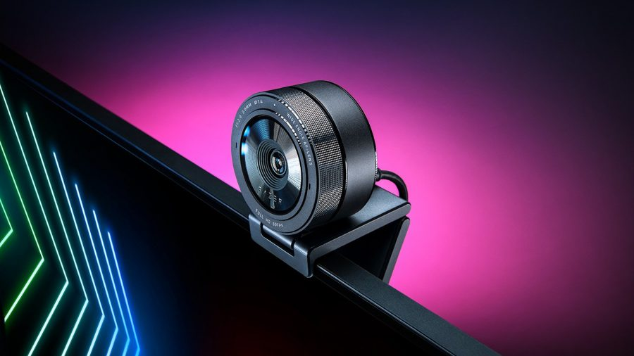 A circular webcam sat on top of a monitor