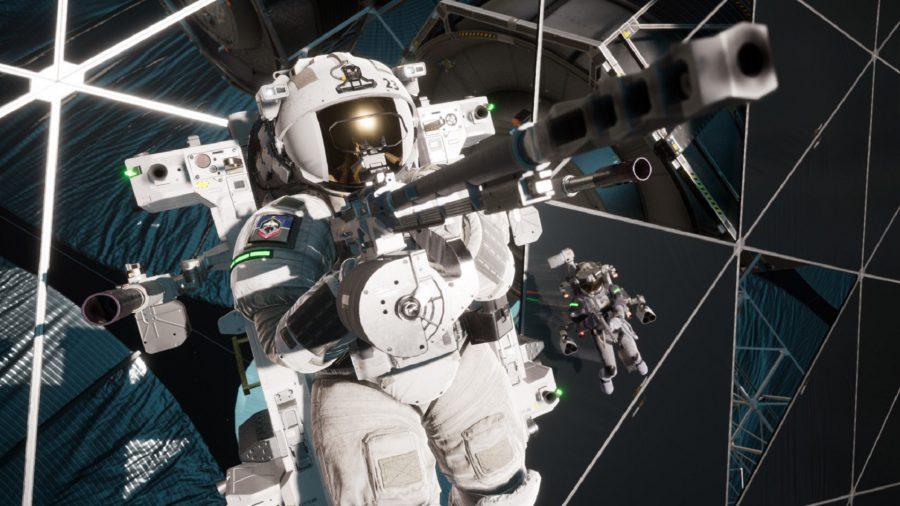 An astronaut carries a huge gun in space