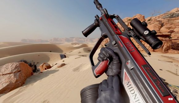 A red and black AUG rifle in front of a desert scene
