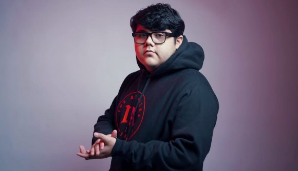 LA Thieves player Venom looking down the camera and rubbing his hands. He is wearing a black hoodie and black-framed glasses