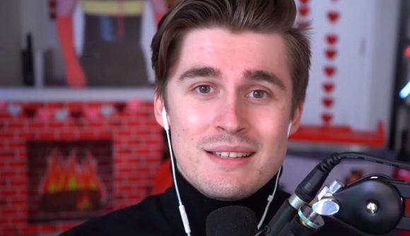 Twitch streamer Ludwig looking down the camera, wearing a black turtle neck and white earphones