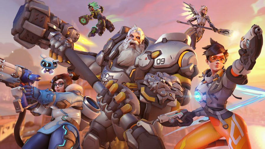 Overwatch's Torbjorn, Mei, and Tracer rush forward, weapons drawn