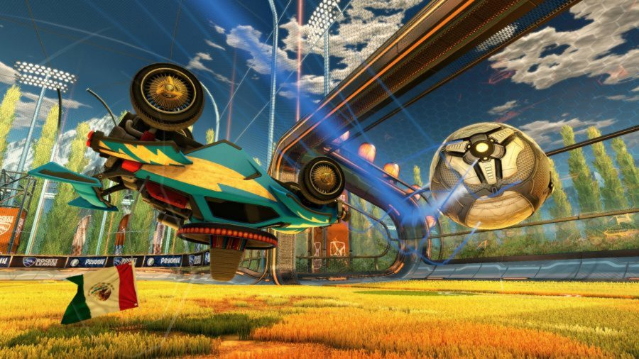 Rocket League ranks: A green car hits the ball while mid-air and upside-down in Rocket League