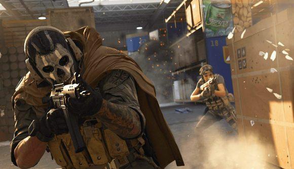 An operator with a skull mask firing a Grau assault rifle.