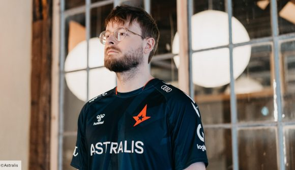 Astralis player promisq wearing a black jersey and glasses