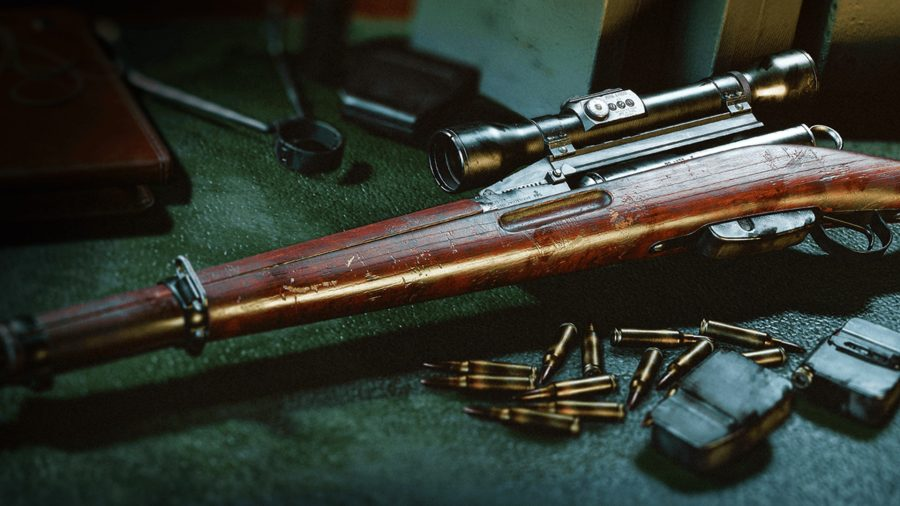 A sniper rifle lies on a table surrounded by bullets and ammo magazines