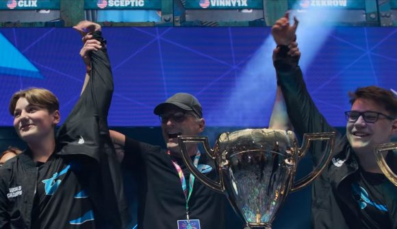 Two Fortnite players have their arms thrown in the air in a winner's pose