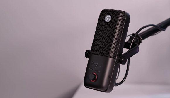 A black elgato microphone on a mic arm
