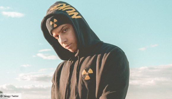 FaZe Swagg in a black hoodie with gold details