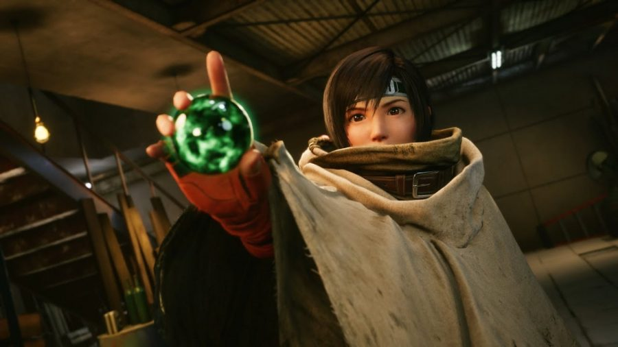 Yuffie, wearing an oversized beige poncho, points towards the camera, holding a green materia orb in her pointing hand