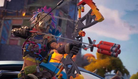 A character dressed in the skeleton of an animal fires an explosive bow