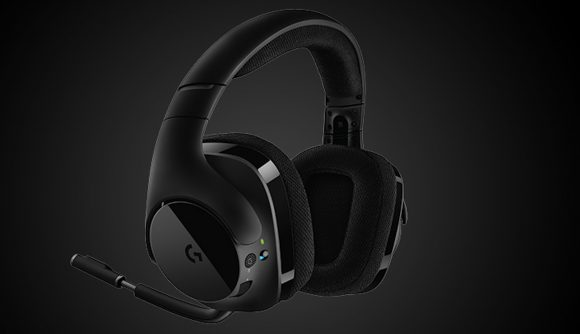 A black wireless headset with a shiny side floats on a gradient black background