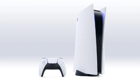 A PlayStation 5 console stands upright next a DualSense controller against a white background