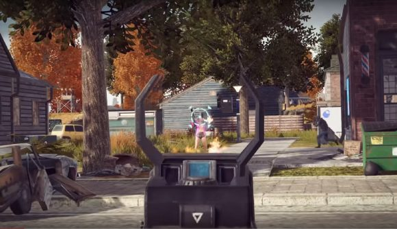 Someone aims down the sights of a weapon, pointing at an opposing player