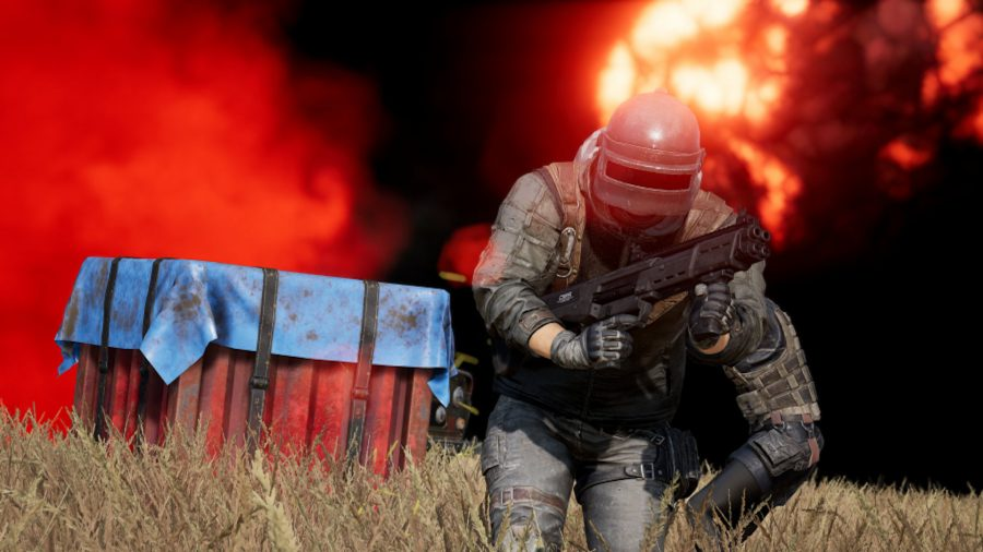 A man with a big helmet and a shotgun runs away from a red smoking supply crate