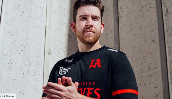 LA Thieves Call of Duty pro Slasher, wearing a black and red jersey, rubs his hands and looks away to his left