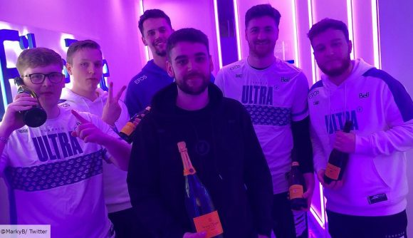 The Toronto Ultra Call of Duty team pose for a victory photo holding bottles of champagne