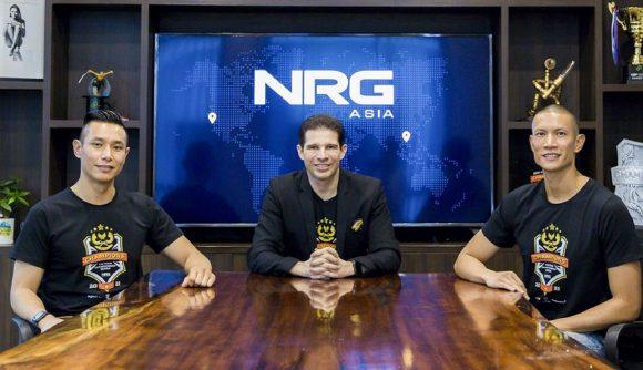 Three executives of NRG Asia sit at a desk
