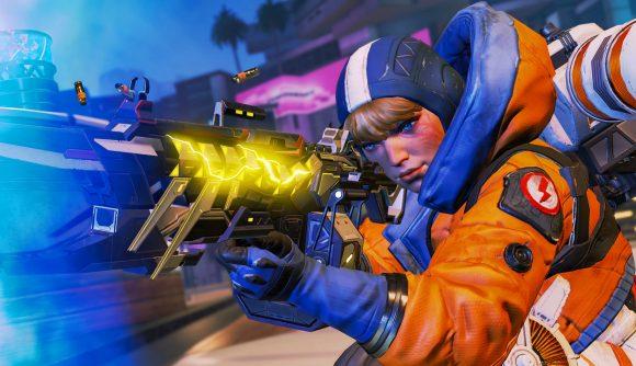 Wattson, wearing an orange and blue flight suit, shoots a rifle