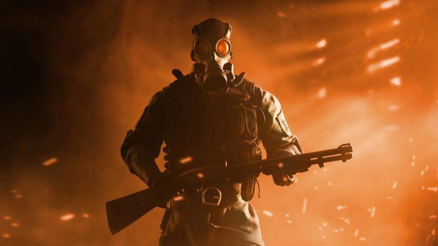 A man wearing a gas mask grips a pump shotgun tightly