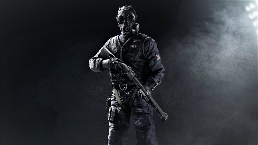 Thatcher stands with his shotgun across his body