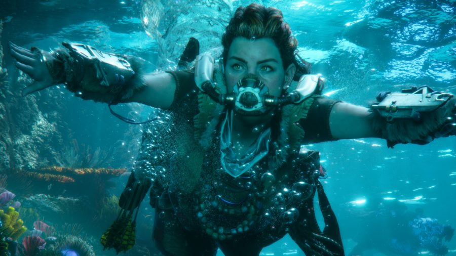 Aloy swims underwater with breathing apparatus over her mouth and nose
