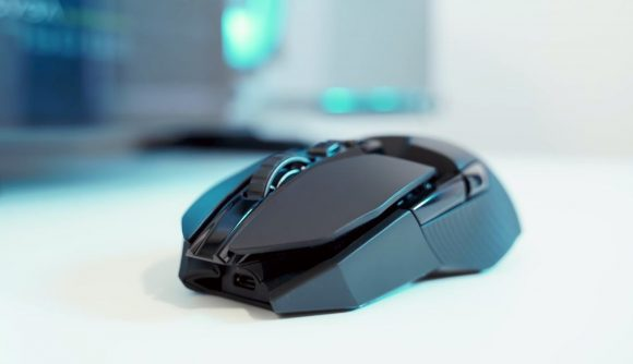 A black wireless gaming mouse on a white table top