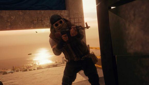A PUBG character firing a rifle