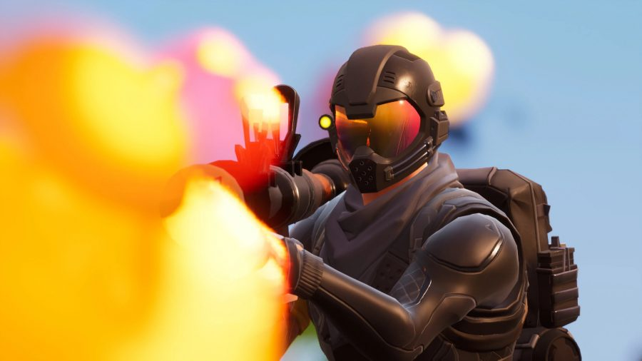 A heavily armoured Fortnite agent fires an RPG