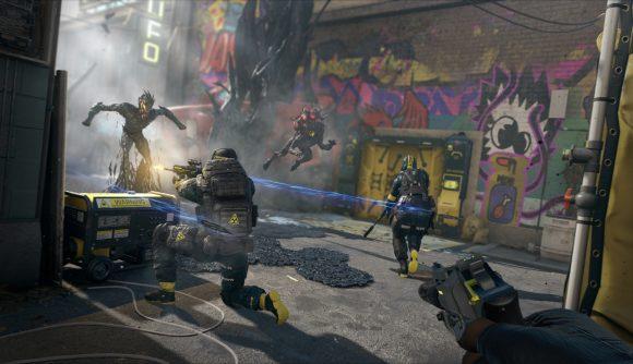 Three Extraction operators fight aliens in a neon lit lleyway