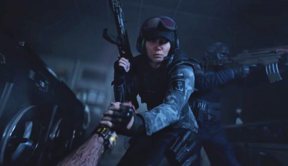 An operator wielding a gun in Rainbow Six Extraction