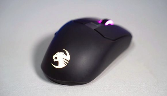 a Roccat gaming mouse in black, with a light-up logo and mouse wheel
