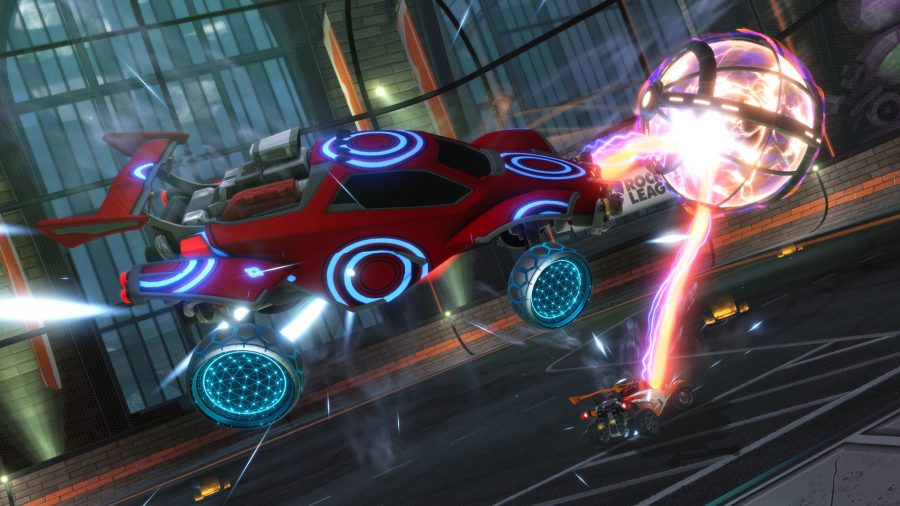A red Rocket League car clearing the ball