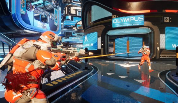 Two players in orange exo suits engage in a gun battle