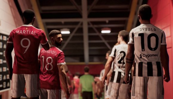 Players from Manchester United and Juventus walking down the tunnel of a football stadium