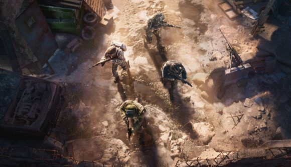 Four soldiers stealthily move through a dusty area